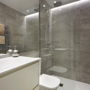 Inspiration for a small modern cloakroom in Other with open cabinets, white cabinets, grey tiles, porcelain tiles, grey walls, slate flooring, quartz worktops and grey floors.