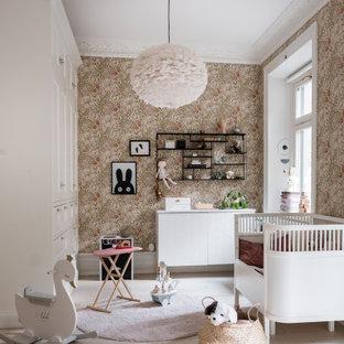 Foto på ett minimalistiskt babyrum