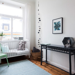 Inspiration for a medium sized scandi gender neutral nursery in Stockholm with white walls and vinyl flooring.