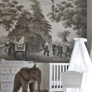 Inspiration for a medium sized world-inspired gender neutral nursery in Berlin with medium hardwood flooring and grey walls.