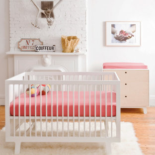 Design ideas for a contemporary nursery for girls in Hamburg with white walls and painted wood flooring.