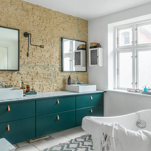 Inspiration for a mid-sized eclectic bathroom remodel in Aarhus with flat-panel cabinets, green cabinets and a vessel sink