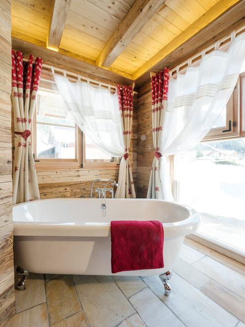 Idee Für Mittelgroße Urige Badezimmer Mit Freistehender Badewanne, Brauner  Wandfarbe Und Kalkstein In Frankfurt Am