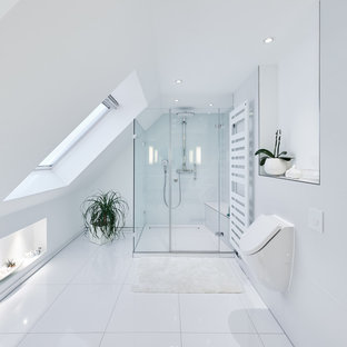 Design ideas for a modern bathroom in Cologne with a bidet, white tile, white walls and a hinged shower door.