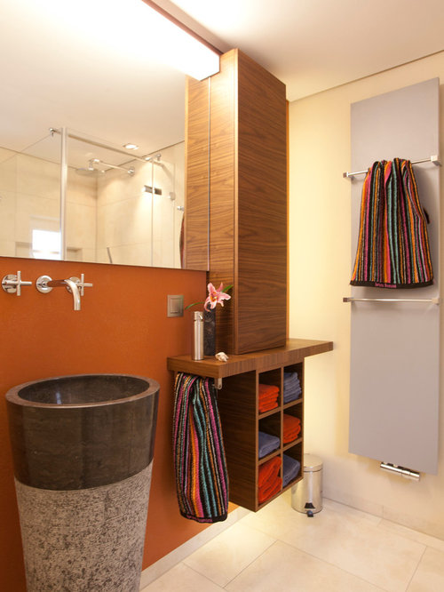 Best bath with brown cabinets and orange walls design for Orange and brown bathroom ideas