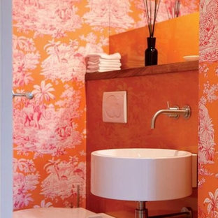 Inspiration for a small contemporary master bathroom in Frankfurt with a wall-mount sink, wood benchtops, a wall-mount toilet, ceramic tile and orange walls.