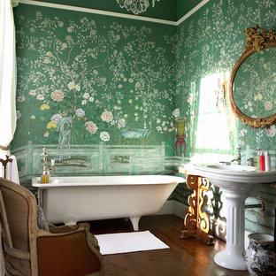 Design ideas for a medium sized traditional ensuite bathroom in Berlin with a freestanding bath, green walls, dark hardwood flooring and a pedestal sink.