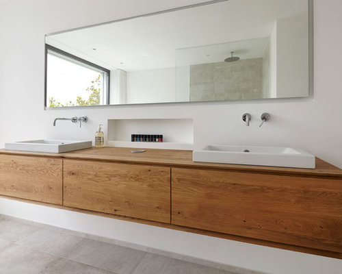 75 bathroom with wooden worktops and limestone tiles. Black Bedroom Furniture Sets. Home Design Ideas