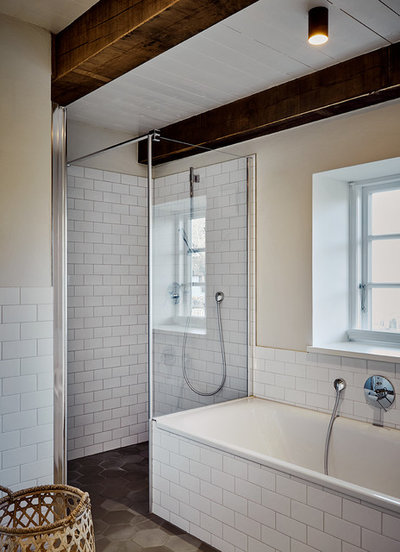 Farmhouse Bathroom by grotheer architektur