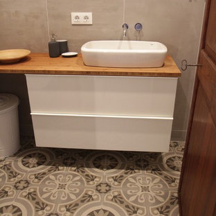 Example Of A Small Tuscan 3 4 Beige Tile And Ceramic Cement Floor