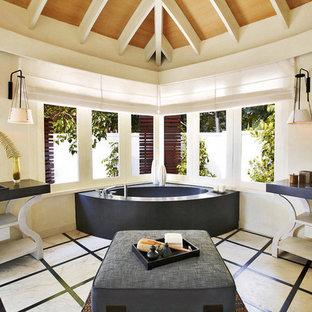 Imagen de cuarto de baño principal, de estilo zen, grande, con baldosas y/o azulejos blancas y negros, losas de piedra, suelo de mármol, encimera de mármol y lavabo encastrado