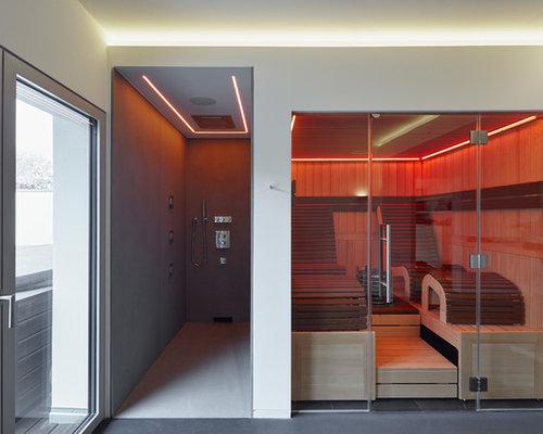 Mittelgroßes Modernes Badezimmer Mit Weißer Wandfarbe, Betonboden Und Sauna  In Köln