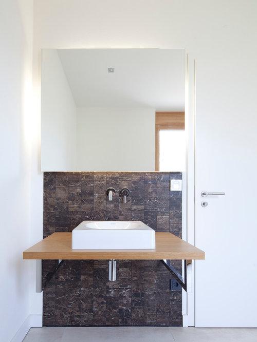 badezimmer mit aufsatzwaschbecken und braunen fliesen. Black Bedroom Furniture Sets. Home Design Ideas