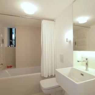 Идея дизайна: главная ванная комната среднего размера в стиле модернизм с накладной ванной, инсталляцией, бежевой плиткой, керамической плиткой, белыми стенами, консольной раковиной и столешницей из искусственного камня