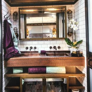 Imagen de cuarto de baño rústico con armarios abiertos, puertas de armario marrones, baldosas y/o azulejos blancos, baldosas y/o azulejos de cemento, lavabo integrado, encimera de cobre y encimeras marrones