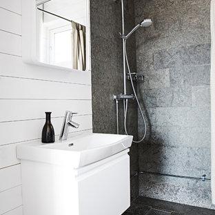 Неиссякаемый источник вдохновения для домашнего уюта: ванная комната среднего размера в скандинавском стиле с плоскими фасадами, белыми фасадами, угловым душем, каменной плиткой, белыми стенами, полом из известняка, душевой кабиной, монолитной раковиной и столешницей из плитки