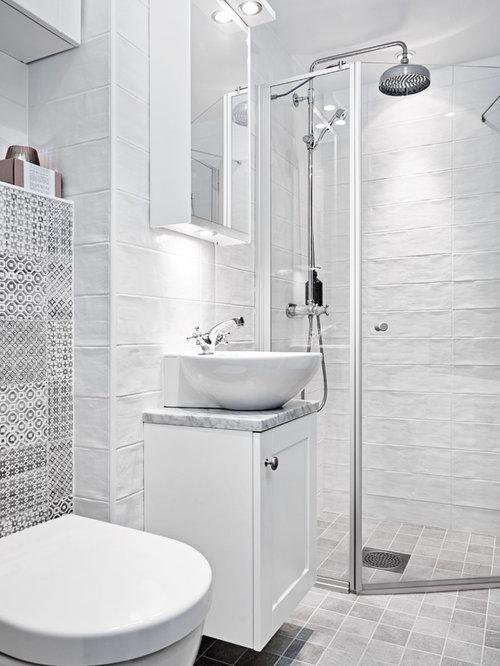 salle de bain scandinave avec une baignoire sur pieds. Black Bedroom Furniture Sets. Home Design Ideas