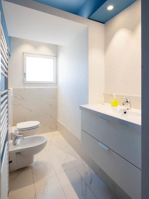 Foto e idee per bagni di servizio bagno di servizio - Piastrelle bianche bagno ...
