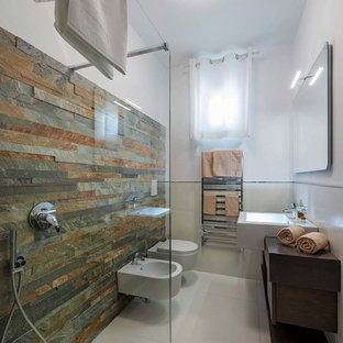 Inspiration for a medium sized contemporary cloakroom in Turin with dark wood cabinets, a wall mounted toilet, multi-coloured tiles, slate tiles, white walls, a trough sink and wooden worktops.