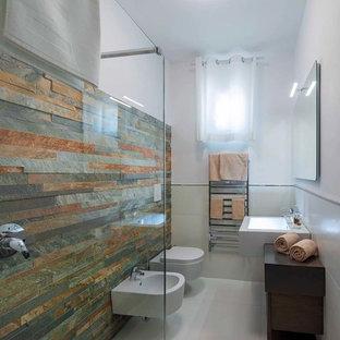 На фото: туалет среднего размера в современном стиле с темными деревянными фасадами, инсталляцией, разноцветной плиткой, плиткой из сланца, белыми стенами, полом из керамогранита, раковиной с несколькими смесителями, столешницей из дерева и белым полом