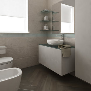 Inspiration for a small modern cloakroom in Other with flat-panel cabinets, white cabinets, a two-piece toilet, beige tiles, porcelain tiles, white walls, porcelain flooring, a vessel sink, glass worktops, brown floors and turquoise worktops.