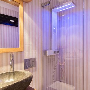 На фото: туалет в современном стиле с бежевой плиткой и мраморной столешницей с