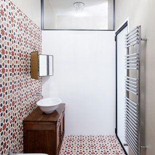 Design ideas for a small industrial cloakroom in Rome with freestanding cabinets, dark wood cabinets, a bidet, multi-coloured tiles, ceramic tiles, white walls, ceramic flooring, a vessel sink, wooden worktops and multi-coloured floors.