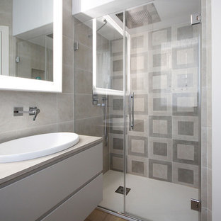 Photo of a medium sized modern cloakroom in Other with flat-panel cabinets, light hardwood flooring, beige cabinets, a one-piece toilet, ceramic tiles, beige walls, a built-in sink, brown floors, multi-coloured tiles, quartz worktops and beige worktops.