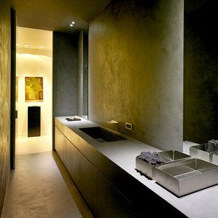 Immagine di un piccolo bagno di servizio moderno con ante lisce, pareti grigie, lavabo da incasso, top in superficie solida e pavimento grigio