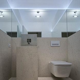 Пример оригинального дизайна: маленький туалет в современном стиле с инсталляцией, разноцветными стенами, темным паркетным полом, монолитной раковиной и столешницей из нержавеющей стали
