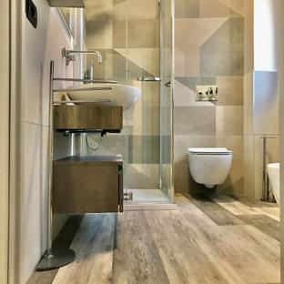 На фото: маленький туалет в стиле лофт с плоскими фасадами, коричневыми фасадами, инсталляцией, керамогранитной плиткой, серыми стенами, полом из ламината, настольной раковиной, столешницей из ламината и коричневой столешницей с