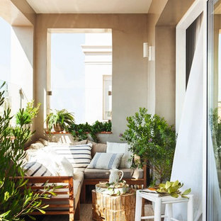 Inspiration for a small mediterranean balcony in Other with a roof extension.
