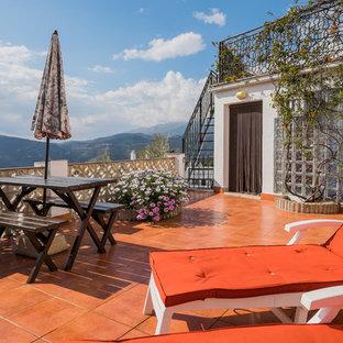 Ejemplo de balcones mediterráneo, grande, sin cubierta