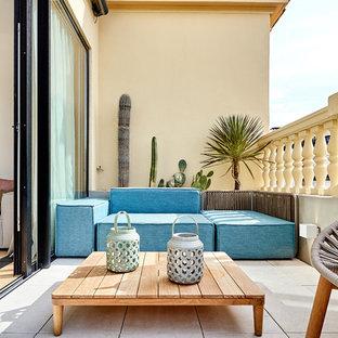 Ejemplo de balcones clásico renovado con jardín de macetas