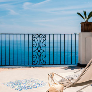 Inspiration for a medium sized mediterranean balcony in Naples with no cover.