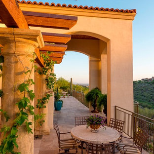 Design ideas for a mediterranean balcony in Phoenix with a roof extension.
