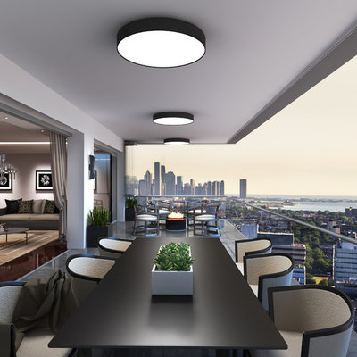 Inspiration for a huge contemporary balcony remodel in Chicago with a roof extension