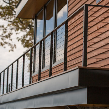 Balcony Railing with Black Cables and Fittings