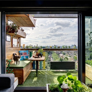 Photo of a small and mixed industrial balcony in London.