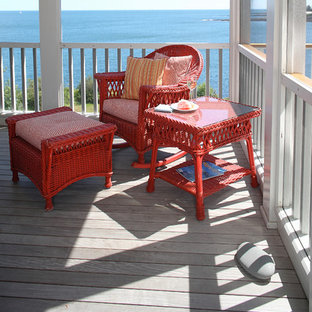 Mid-sized coastal balcony photo in Portland Maine with a roof extension