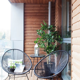 Contemporary balcony in London with a roof extension.