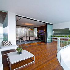 Contemporary Porch by DESIGN INTERVENTION