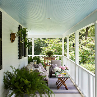 This is an example of a farmhouse balcony in New York with a roof extension.