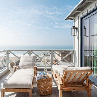 Beach style mixed material railing balcony photo in Los Angeles with no cover
