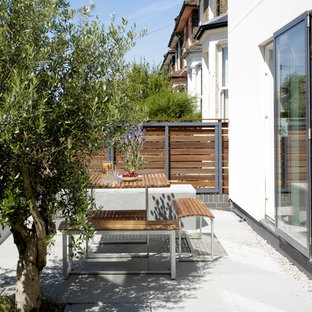 Photo of a small contemporary balcony in London with no cover.