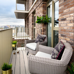Small contemporary metal railing terrace and balcony in London with no cover.