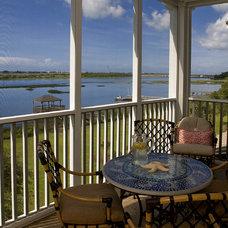 Beach Style Porch by Blue Sky Building Company