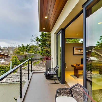 Inspiration for a small contemporary balcony remodel in San Diego with a roof extension