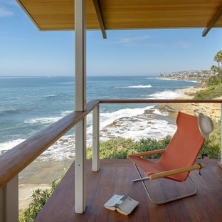 Inspiration for a mid-sized coastal balcony remodel in San Diego with a roof extension