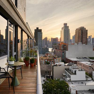 Balcony - small contemporary glass railing balcony idea in New York with no cover